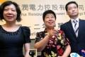 (From left) China Resources Power chief financial officer Wang Xiaobin, chairwoman Zhou Junqing and president Wang Yujun. Photo: May Tse