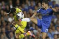 Chelsea's new signing Eden Hazard (right) competes for the ball with Reading's Jobi McAnuff in their Premiership clash in London. Photo: AP