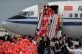 China's gold medallists arriving at Chek Lap Kok. Photo: AFP