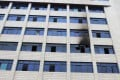 A smoke-blackened window is seen at an office building in Shaoyang city, Hunan, on Monday. Photo: SCMP Pictures