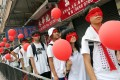 Students protesting against national education wear red blindfolds and carry red balloons in Shau Kei Wan. Photo: David Wong