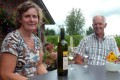 Job and Neeltje Huisman drink a Nieuw Tivoli 2011, a white wine produced from the special grapes in their vineyards. Photo: AFP