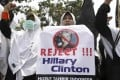 Muslim women protest against the visit of US Secretary of State Hillary Rodham Clinton outside the US embassy in Jakarta. Photo: AP