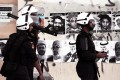 Bahraini riot policemen search for anti-government protesters during clashes in Sitra on Monday. Pictures of jailed political leaders behind last year's uprising and people killed in the ensuing unrest are plastered on the wall. Photo: AP