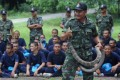 A Thai soldier holds a cobra as teenage students take part in Thai army bootcamp training at a military camp in Lopburi province. Photo: AFP.