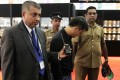 Security officials escort a Chinese national accused of stealing a USD$13,800 diamond by swallowing it at Sri Lanka's main gem fair in Colombo. Photo: AFP