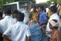 People gather around a dead body to be identified at a cracker factory in Tamilnadu on Wednesday. Photo: Xinhua