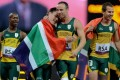 Oscar Pistorius (second right) celebrates a win in the 4x100m relay on Wednesday in London. Photo: Xinhua