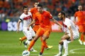 Dutch player Robin van Persie (centre) in action against Omer Toprak (right) from Turkey during their FIFA World Cup 2014 qualifying soccer match in Amsterdam, Netherlands. Photo: EPA