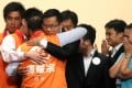 Chan Han-pan hugs party chairman Tam Yiu-chung at AsiaWorld-Expo after winning his New Territories West seat. Photo: K.Y. Cheng