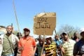 Striking miners listen to Julius Malema's speech. Photo: AP