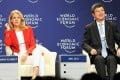 International Monetary Fund deputy managing director Zhu Min (right), with Danish Prime Minister Helle Thorning-Schmid, attends an interactive session on the European crisis at the World Economic Forum in Tianjin on Tuesday. Photo: AFP