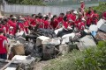 The 200 volunteers from Nomura bank and Ecovision Asia collected over 200 bags of trash on Lamma Island. Photo: David Wong