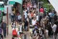 Travellers wait outside Sheung Shui station. Photo: Sam Tsang