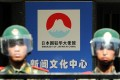 Beijing riot police stand guard the Japanese embassy on Sunday as protesters rally outside after Tokyo announced it had bought the Diaoyu islands. Photo: AFP