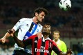 AC Milan's forward Kevin Constant (right) fights for the ball in a match against Atalanta on Saturday. Photo: AFP