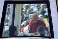 Pope Benedict XVI greets people from his popemobile in Bkerke on Sunday. Photo: AFP