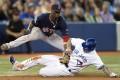 Brett Lawrie (right) is tagged out at third base by Boston Red Sox third baseman Pedro Ciriaco on Saturday. Photo: AP