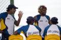 Kumar Sangakkara (left), Lasith Malinga and other Sri Lankan players break during a practice session yesterday. Photo: AP