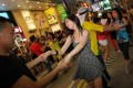 International Zouk Flash Mob members dance outside Fashion Walk - while news footage of riots played on big screens. Photo: Nora Tam