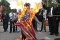Pakistani lawyers shout slogans as they burn a US flag and an effigy of US President Barack Obama and Florida pastor Terry Jones during a protest in Multan on Monday. Photo: AFP