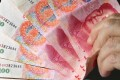 Beijing maintains tight control on onshore yuan exchange rate.