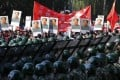 Rows of soldiers stand guard as protesters with portraits of Mao Zedong gather at the Japanese embassy in Beijing. Photo: Reuters