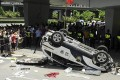 A police car made by Honda is smashed up by anti-Japan protesters in August. Honda Motor said it had temporarily closed all five of its China plants after violent demonstrations. Photo: AP