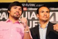 Manny Pacquiao, left, and Juan Manuel Marquez face the media cameras during a Press Conference at Beverly Hills Hotel in California on Monday. Photo: AFP