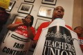 Striking Chicago public school teachers attend a press conference by The Chicago Teachers Solidarity Campaign outside the office of Mayor Rahm Emanuel in City Hall, Chicago, Illinois on Monday. Photo: AFP