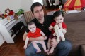 Academic with his two children, aged 18 and 8 months. Photo: SCMP