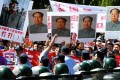 Demonstrators carry Deng Xiaoping (left) and Mao Zedong portraits during a protest over the Diaoyu islands outside the Japanese embassy in Beijing on Tuesday. Photo: AFP