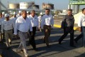 Director of Mexican state-run company Petroleos Mexicanos Juan Jose Suarez Coppel (centre) and Governor of state of Tamaulipas Egidio Torre Cantu (left) visit the refinery of the company after an explosion and a resulting fire, in Reynosa, Mexico.