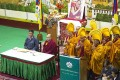 Exiled Tibetan Buddhist monks, in yellow ceremonial hats, pray during the opening ceremony of a special meeting in Dharamshala, India, on Tuesday. Photo: AP