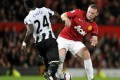 Manchester United's Wayne Rooney (right) is tackled by Newcastle's United's Cheick Tiote (left) during their English League Cup third round match at Old Trafford in Manchester, England on Wednesday. Photo: Associated Press