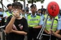 Scholarism convenor Joshua Wong shouts slogans in a stand-off with police yesterday. Photo: Nora Tam