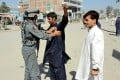Afghan police works a checkpoint on a road in Khost after a suicide bomb attack on Monday. Photo: EPA