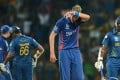 England's captain Stuart Broad (centre) wipes his face as his opponents from Sri Lanka go back to their creases. Photo: AFP