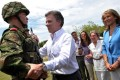 President Juan Manuel Santos (centre) greeting his son Esteban Santos during the delivery of weapons to new soldiers at the Tolemaida Army Base. Photo: AFP