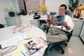 Next Media boss Lai Chee-ying reads Next Magazine in his Taipei office. Lai has sold his TV business there. Photo: Apple Daily
