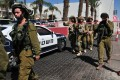 Israeli anti-terror personnel stand outside the Leonardo Club Hotel in Eilat on Friday. Photo: Xinhua