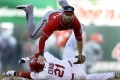 Cardinals' Allen Craig (21) is out at second as Nationals' second baseman Danny Espinosa turns the double play. Photo: AP