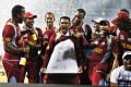 West Indies' cricketer Denesh Ramdin (centre) celebrates with teammates in Colombo, Sri Lanka, on Sunday. Photo: AP