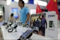 Mobile devices are displayed on a ZTE sales counter in Wuhan, central China's Hubei province on October 8, 2012. Photo: AFP