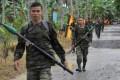 MILF rebels carrying rocket propelled grenades patrol inside their base at Camp Darapan, Sultan Kudarat province, Mindanao. Photo: AFP