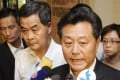 In a move that hit a raw nerve among many, Li Gang speaks to the press ahead of Leung Chun-ying. Photo: SCMP