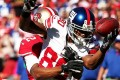Wide receiver Victor Cruz of the New York Giants bobbles a pass against Carlos Rogers of the 49ers on Sunday. Photo: AFP
