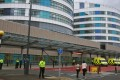 Police officers stand guard around the Queen Elizabeth Hospital in Birmingham where 14-year-old Malala Yusufza arrived for treatment on Monday. Photo: EPA