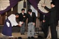 Shinzo Abe puts on his shoes after his controversial visit to the Yasukuni Shrine in Tokyo. Photo: AFP