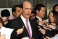 US ambassador to Japan John Roos (centre) is surrounded by reporters after his meeting with Japanese Senior Vice Foreign Minister Shuji Kira in Tokyo on Wednesday. Photo: AFP